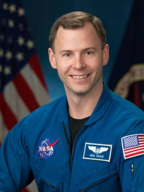 Official astronaut portrait of Tyler (Nick) Hague - Blue Flight Suit Picture. Photo Date: January 13, 2014. Location: Building 8, Room 183 - Photo Studio. Photographer: Robert Markowitz